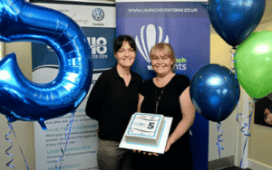 Nichola and Jo stood with Leigh Business Expo's 5th Birthday cake
