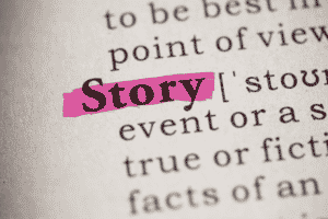 Image of the word story highlighted in pink from a page in a book