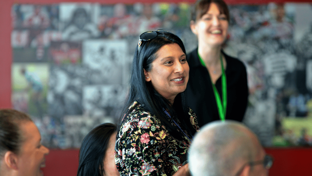 photograph shows lady speaking at a networking event
